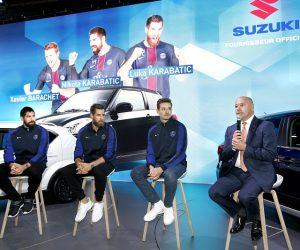 Les joueurs du PSG Handball en visite sur le stand Suzuki lors du Mondial de l'Automobile