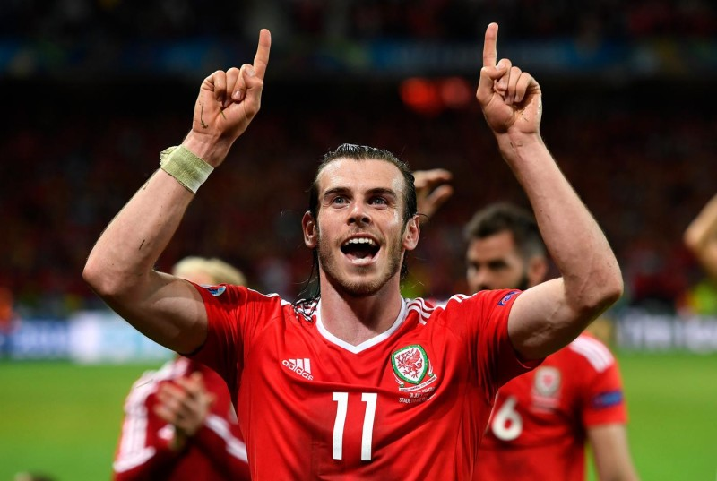 LILLE, FRANCE - JULY 01: Gareth Bale of Wales celebrates his team's 3-1 win after the UEFA EURO 2016 quarter final match between Wales and Belgium at Stade Pierre-Mauroy on July 1, 2016 in Lille, France. (Photo by Stu Forster/Getty Images)